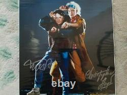 BACK TO THE FUTURE SIGNED(L)11X14 MICHAEL J FOX. //CHRISTOPHER LLOYD/With (COA)